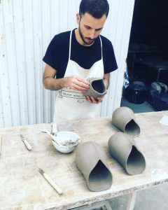 Ceramics artist Luis Torres in his pottery studio Torres Ferreras in La Rambla Spain making Crisalida design flowepots