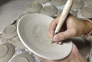 Engraving on ceramics by hand by Luis Torres ceramics in pottery studio Torres Ferreras from La Rambla Cordoba Spain
