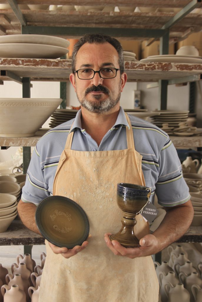 Master artisan Miguel Angel Torres Ferreras with his handmade ceramics holy chalice for Pope Francis I