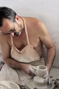 Master artisan Miguel Angel Torres Ferreras working on his potter's wheel in his ceramics studio in La Rambla Cordoba Spain